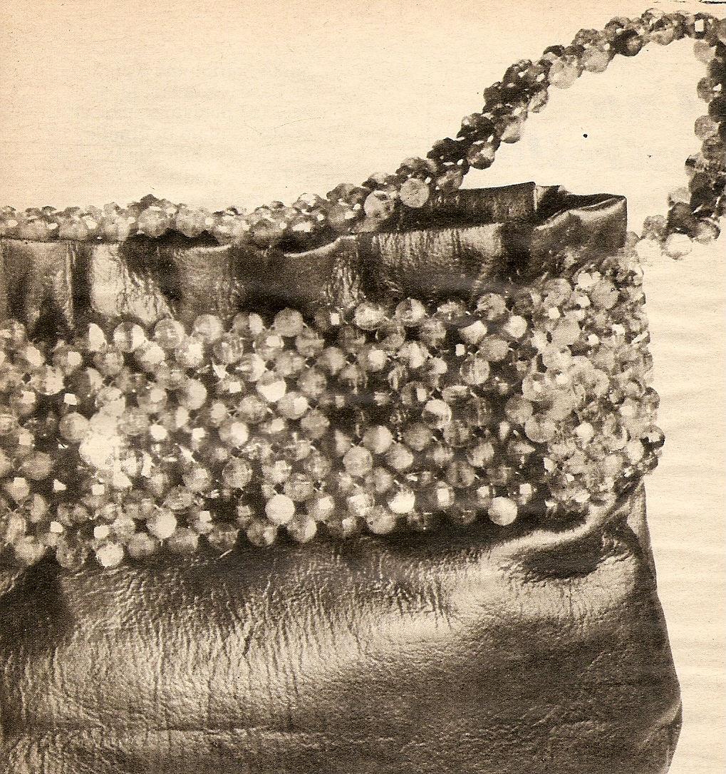 Cartera o bolso de cuerina y piedras
