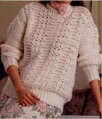 Cómo tejer un suéter blanco con ribetes dorados