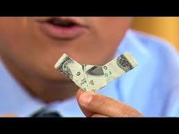Como doblar un dolar de la suerte