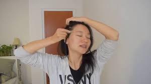 Masaje facial con piedra de jade